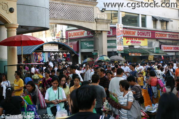 Crowd of Shoppers and Vendors along Evangelista Street and in Front of Carriedo Flea Market