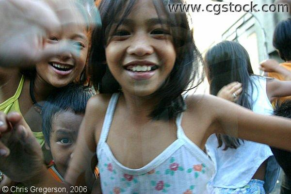Smiling Young Girl and Playmates in Delpan, Tondo, in Manila