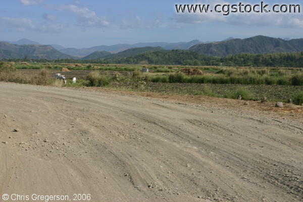Gravel Road, Farmland, and Mountains in Ilocos Norte, the Philippines