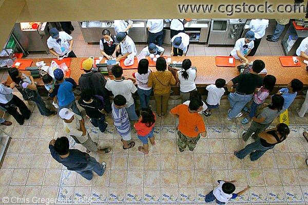 Overhead View of Customers at a Jollibee (Fast Food) Counter in the Philippines
