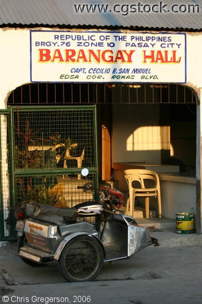Tricycle Parked In Front of a Barangay Hall