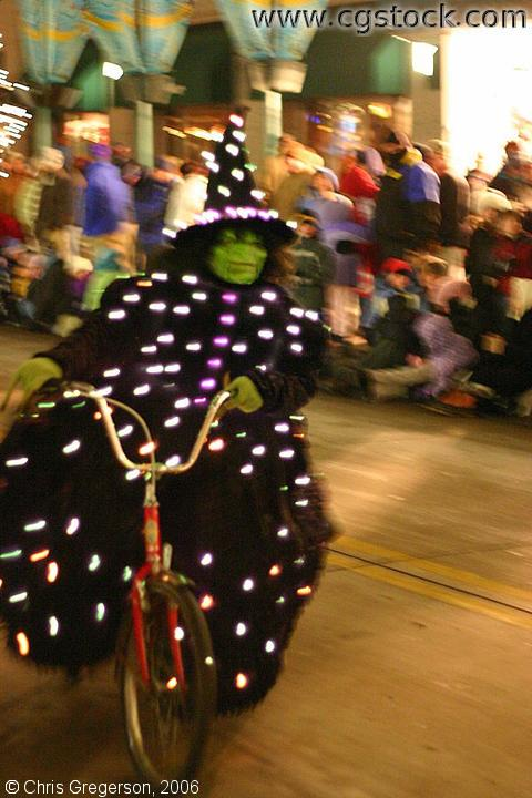 Stock Photo Wicked Witch On A Bike In The Holidazzle Parade