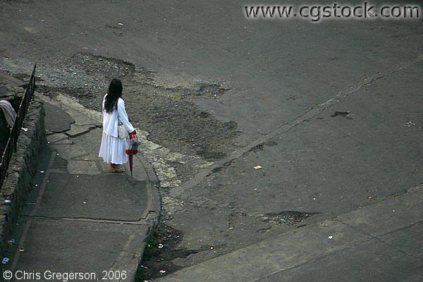 A Lady in White at the Corner of a Street in Baguio City, Philippines