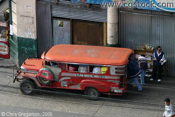 A Red Jeepney Loading a Passenger in Mabini Street, Baguio City, Philippines
