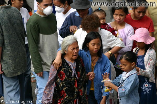 A Grandmother and Her Granddaughters on Session Road in Baguio City, Philippines