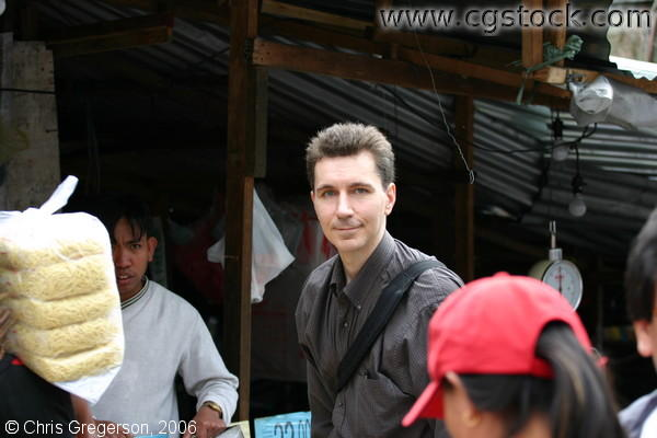 Chris In Front of a Rice Grain Vendor in Baguio Public Market