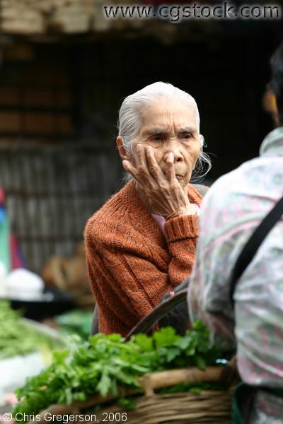 An Old Woman Resting Her Head on Hands in the Baguio Public Market