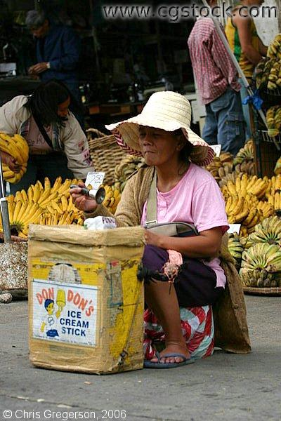 An Old Woman Selling Ice Cream Sticks in the Baguio Public Market Sidewalk