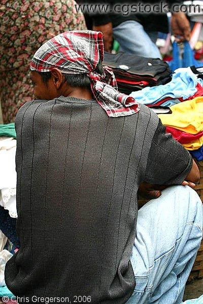 Back of a Man Squatting and Wearing a Headscarf in the Baguio Public Market