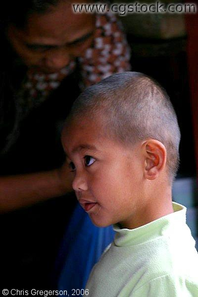 Close Up of a Small Boy With a Crew-Cut