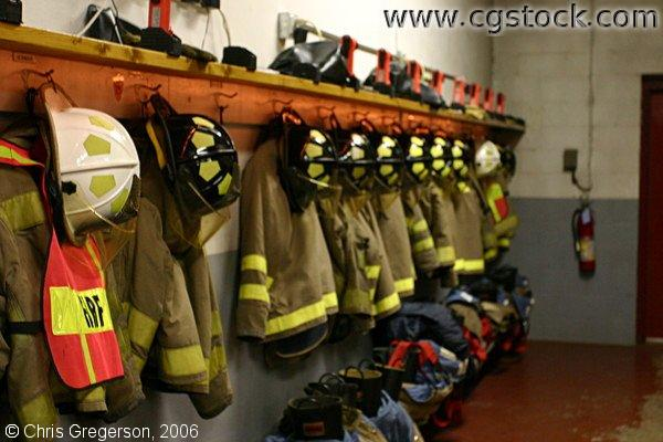 Helmets, coats, and boots inside fire station in New Richmond, Wisconsin, USA