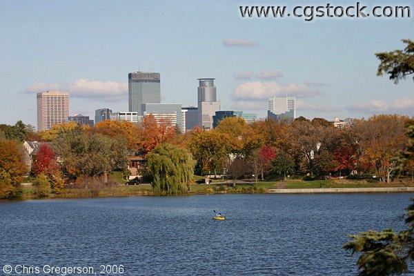 Minneapolis skyline viewed from across Lake of the Isles in fall