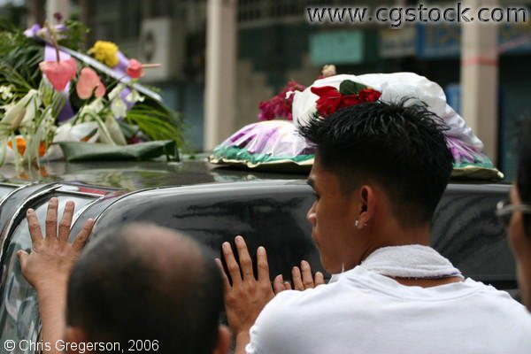 Filipino Boy's Brother Walking Behind the Hearse