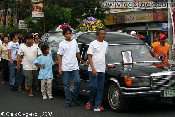 Filipino Father with Mourners During his son's Funeral Procession