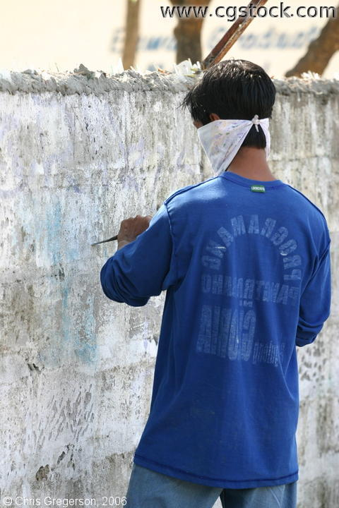 Worker Preparing a Wall for Cement Finishing and Painting in Angeles City, Pampanga
