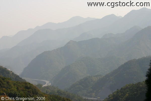Mountain and Pass Veiled in Smog