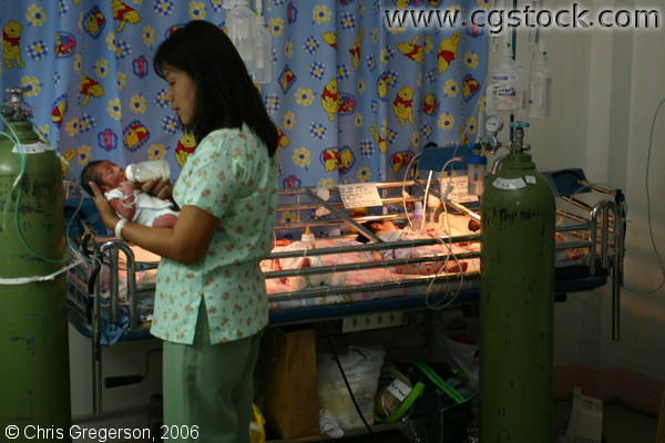 Nurse Bottle-Feeding Baby in the Nursery of Ospital ng Angeles (ONA)