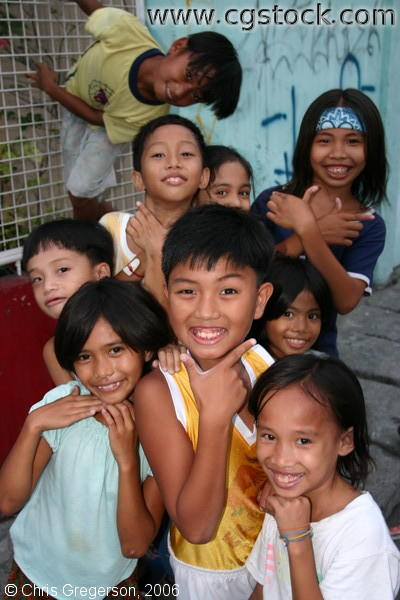 Group of Filipino Kids Happily Posing for the Camera