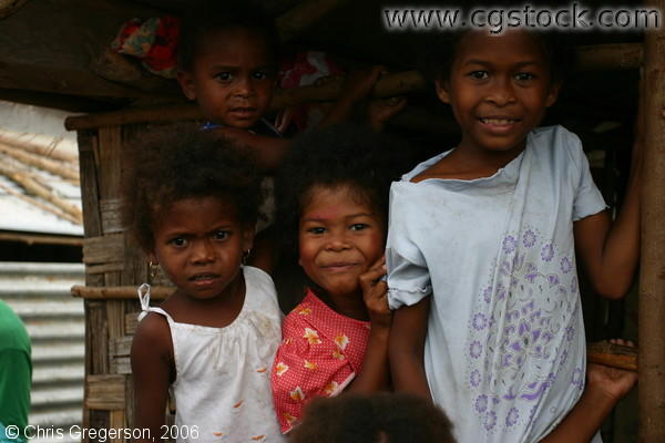 Aeta Girls Standing by a Nipa Hut