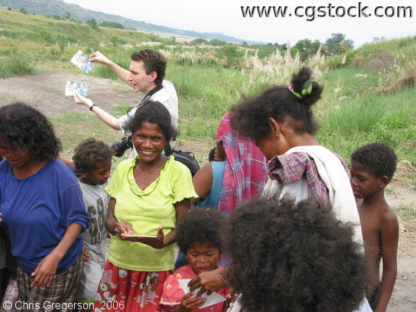 Chris Handing Out Photos in Aeta Settlement Village, Pampanga