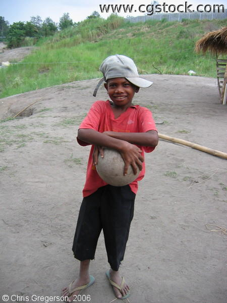 Aeta Boy Holding a Ball in Pampanga