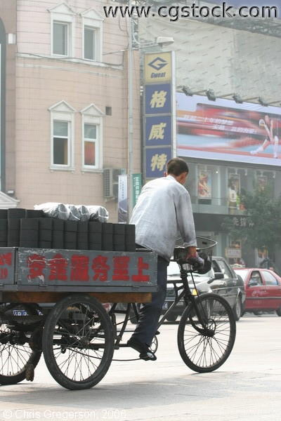 Old Chinese Man Driving Cart with Coal Cylinders