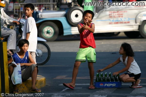 Young Filipino Children Posing on a Sidestreet in Bacoor, Cavite