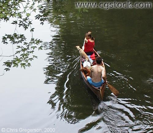 Couple Paddling a Canoe