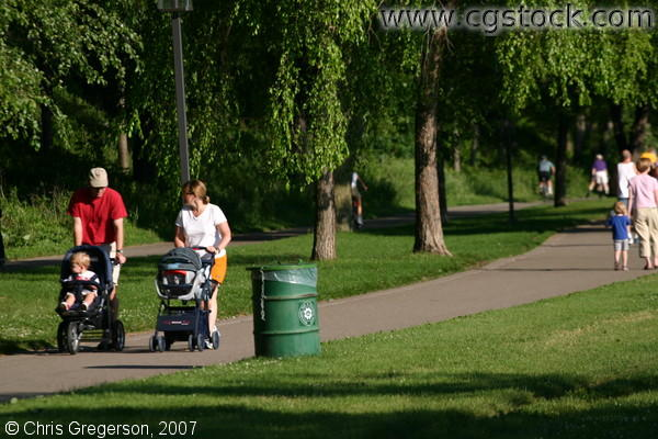 parents pushing a baby stroller