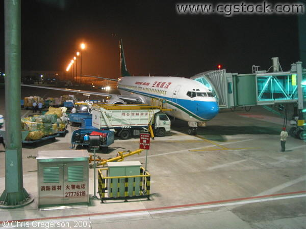 Plane at a Gate at the Shenzhen Airport at Night