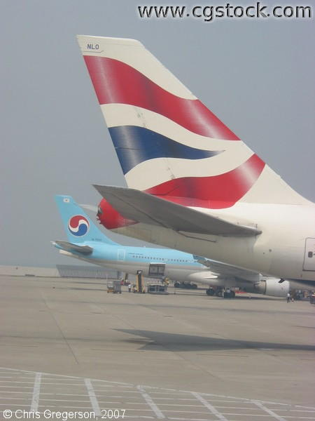 Tail of British Airways and Korean Air Jets in Hong Kong
