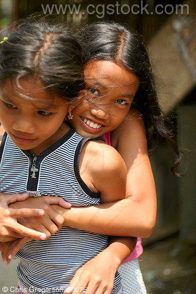 Two Girls Playing in a Village in the Philippines
