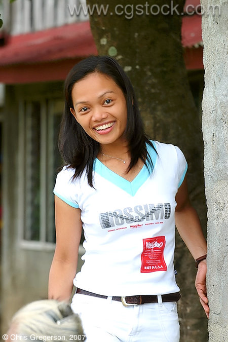 Filipina Smiling while Visiting her Family's Barangay