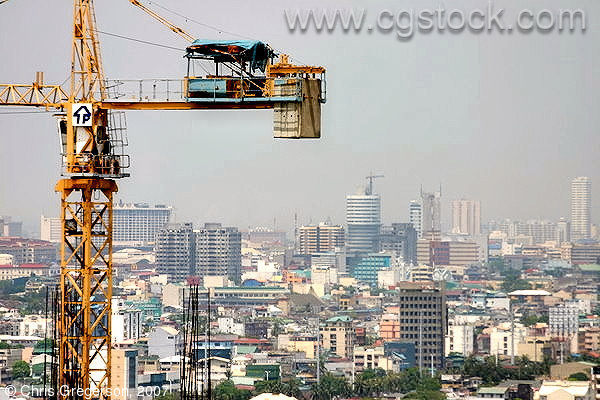 Construction Crane and Manila Rooftops