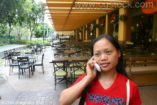 Filipina (Asian) Woman on Cell Phone, Greenbelt 2, Manila