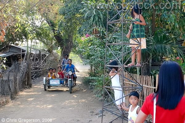 Children Driving a Motorcycle/Trike, the Philippines