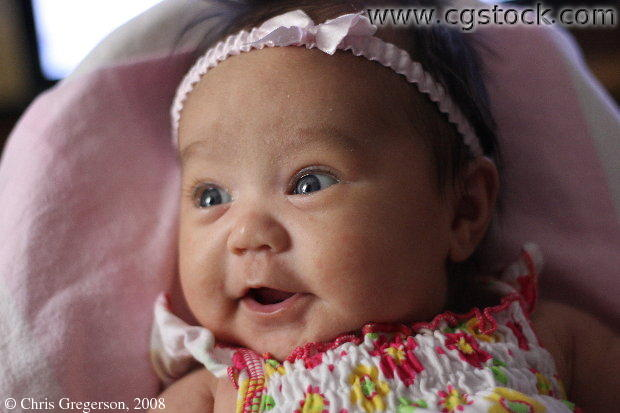 Baby Girl with Pink Bow, Smiling