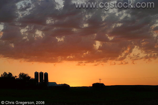 Sunset with Farm Silos in Silhouette