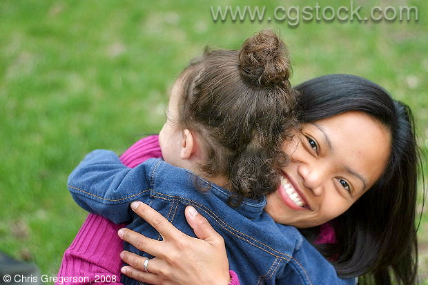 Young Woman and Child Hugging