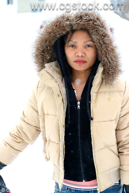 Young Woman in Winter Coat After a Snowstorm