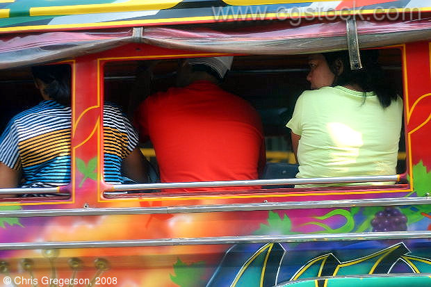 Passengers in Window of a Colorful Jeepney, Manila, Philippines