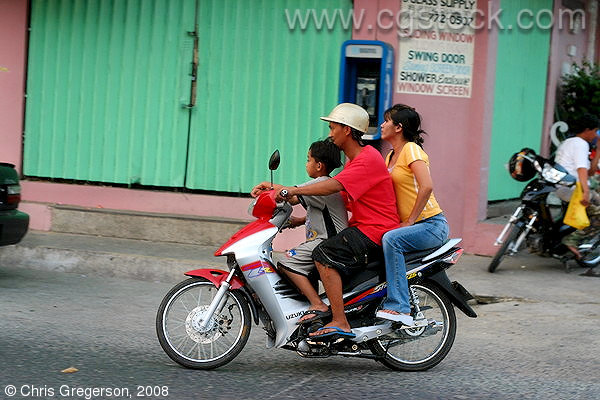Family on a Small Motorcycle Together