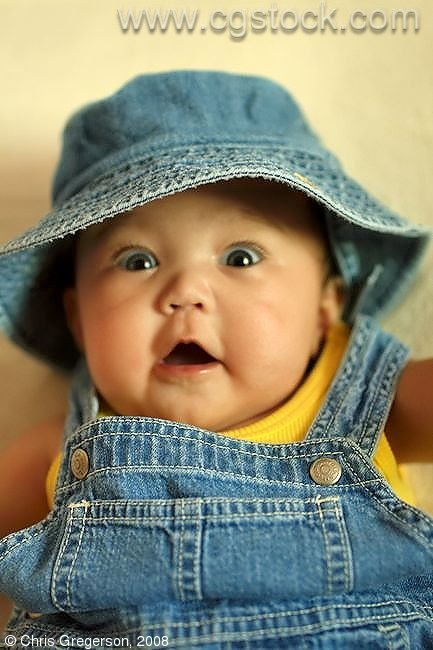 stock photo cute baby in overalls and hat. Black Bedroom Furniture Sets. Home Design Ideas