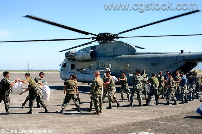 US and Philippine Soldiers Loading Helicopter with Relief Supplies