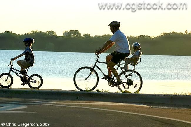 Father and Children Biking Around Lake Calhoun