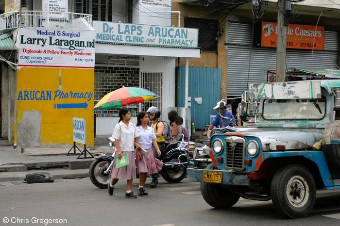 Students Crossing in front of a Jeepney