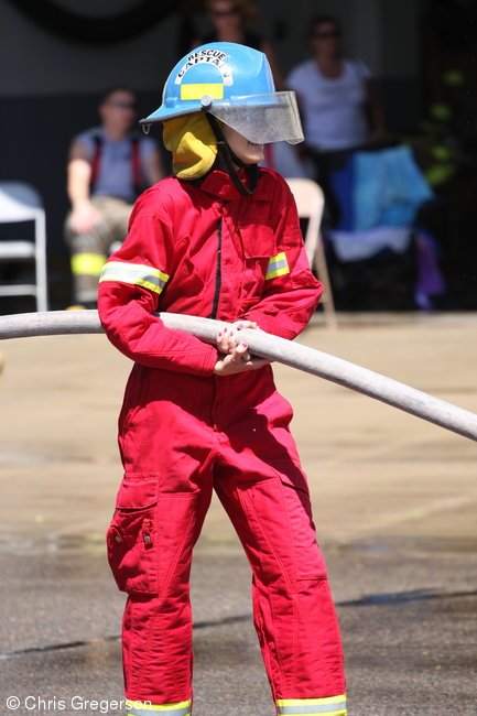 Fire Fighter Holding Water Hose