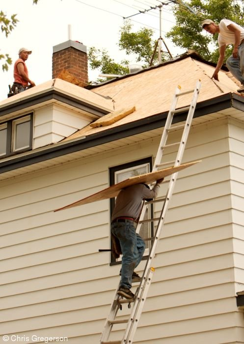 Roofers Replacing Residential Roof
