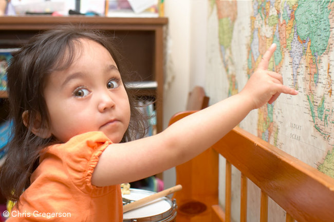 Preschool Girl Pointing to the Philippines on a World Map